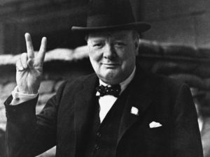 "FILE - This is a Aug. 27, 1941 file photo of British Prime Minister Winston Churchill as he gives his famous "" V for Victory Salute"" . Churchill Britain's famous World War II prime minister died fifty years ago on January 24 1965. (AP Photo, File)"